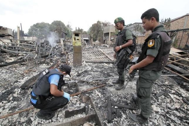 File photo: Thai security personnel inspect the site of a bomb attack, in the southern Narathiwat province