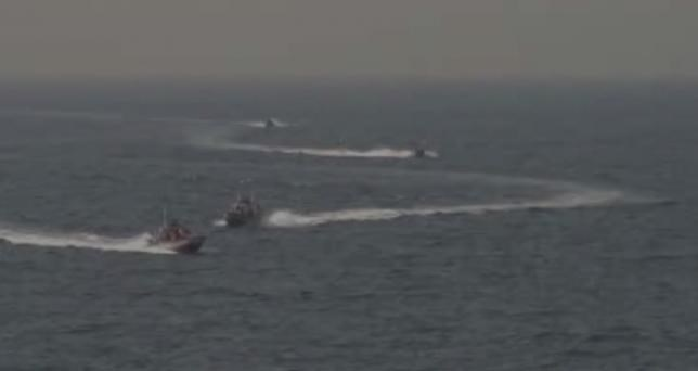Footage taken aboard the USS Nitze of Islamic Revolutionary Guard vessels. via REUTERS TV