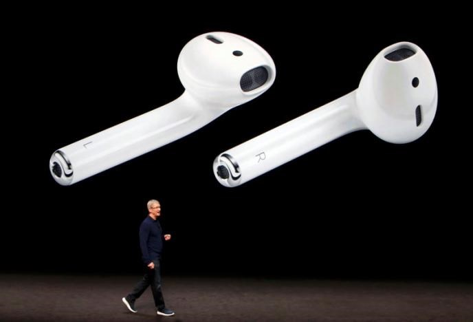 AirPods are displayed as Apple Inc CEO Tim Cook makes his closing remarks during an Apple media event in San Francisco, California, U.S. September 7, 2016.