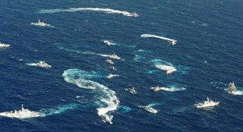 An aerial view shows Japan Coast Guard patrol ship, fishing boats from Taiwan and Taiwan's Coast Guard vessel sailing side by side near the disputed islands in the East China Sea, known as Senkaku in Japan, Diaoyu in China and Tiaoyutai in Taiwan, in this photo taken by Kyodo in this file photo dated September 25, 2012.