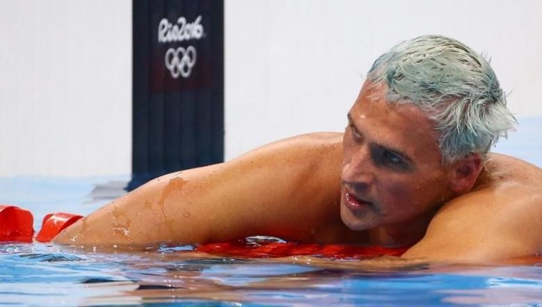 Ryan Lochte (USA) of USA reacts.