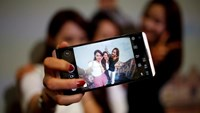 Models pose for photographs with a LG electronics' new V20 premium smartphone during its unveiling ceremony in Seoul, South Korea, September 7, 2016.