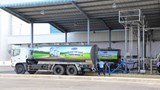 Milk trucks prepare to leave a Vinamilk factory