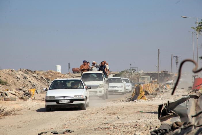 People drive in the Ramousah area of southern Aleppo, after the Syrian army and allied militia advanced in the area, Syria, in this handout picture provided by SANA on September 9, 2016.