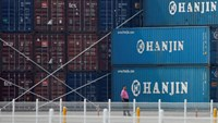 A man stands in front of shipping containers at the Hanjin Shipping container terminal at Incheon New Port in Incheon, South Korea, September 7, 2016.