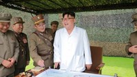 North Korean leader Kim Jong Un provides field guidance during a fire drill of ballistic rockets by Hwasong artillery units of the KPA Strategic Force, in this undated photo released by North Korea's Korean Central News Agency (KCNA) in Pyongyang September 6, 2016.