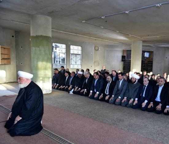 Syria's president Bashar al-Assad(4th R), prays at a mosque in a Damascus suburb of Daraya, Syria in this handout picture provided by SANA on September 12, 2016.