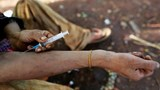 A man injects heroin into his arm along a street in Man Sam, northern Shan state, Myanmar July 11, 2016.