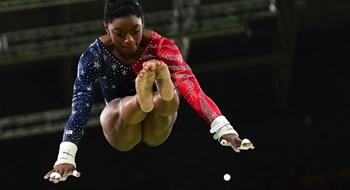 U.S. gymnast Simone Biles competes in the qualifying round for the women's Uneven Bars event in Rio on Aug. 7. Photo: AFP