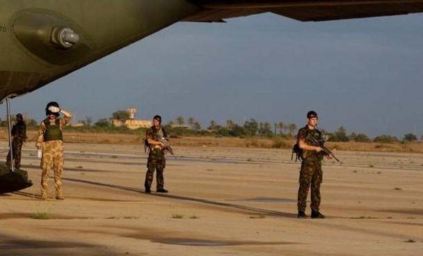 British soldiers stand guard during the visit of defence secretary Liam Fox at Misrata airport 200km (124.2 miles) east of Tripoli in this file October 8, 2011 photo.