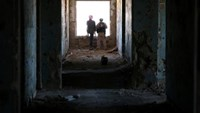 Rebel fighters stand in a damaged building in Quneitra countryside, Syria September 10, 2016.