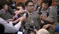 Members of the media scramble to speak with Director general of Malaysia's Civil Aviation Department (DCA), Azharuddin Abdul Rahman (C) at a hotel in Kuala Lumpur on May 27, 2014. Photo credit: AFP