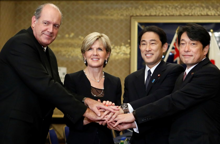 Australia's Defense Minister David Johnston (L) and Foreign Minister Julie Bishop (2nd L) shake hands with Japan's Foreign Minister Fumio Kishida (2nd R) and Defense Minister Itsunori Onodera ahead of their meeting at the Iikura Guest House in Tokyo June
