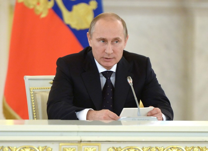 Russian President Vladimir Putin speaks during a meeting of the Presidential Council on Inter-Ethnic Relations in the Kremlin July 3, 2014. Putin will on Friday begin a six-day Latin America tour that will take him to Cuba, Argentina and Brazil as he seek