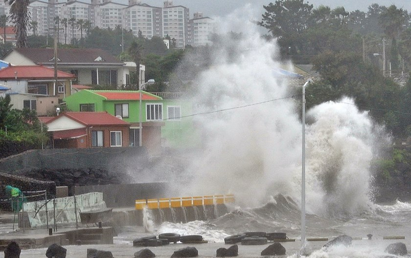 Waves crash as Typhoon Neoguri approaches the village in Seogwipo on Jeju Island July 9, 2014. Jeju Regional Meteorological Administration renewed its alert level from typhoon watches to typhoon warnings for east and west coast of Jeju Island on Wednesday