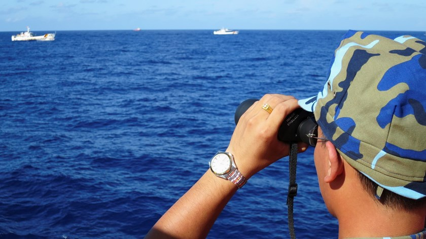 A crewman from the Vietnamese coastguard ship 8003 looks out at sea as Chinese coastguard vessels give chase to Vietnamese ships that came close to the Haiyang Shiyou 981oil rig in the East Sea, a.k.a South China Sea, July 15, 2014. Photo: Reuters
