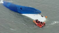 This aerial handout file photo shows coast guard members searching for passengers near a South Korean ferry (C) that capsized on its way to Jeju island from Incheon on April 16, 2014. Student survivors of South Korea's ferry disaster, testifying for the f
