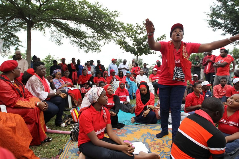 A 'Bring Back Our Girls' campaigner addresses supporters at the Unity Fountain, on the 100th day of the abductions of more than 200 school girls by the Boko Haram, in Abuja July 23, 2014. One hundred days after the Nigerian school girls from the northeast