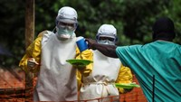 Medical staff working with Medecins sans Frontieres (MSF) prepare to bring food to patients kept in an isolation area at the MSF Ebola treatment centre in Kailahun July 20, 2014. Photo: Reuters
