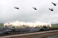 Japanese Ground Self-Defense Force armored tanks fire during an annual training session near Mount Fuji at Higashifuji training field in Gotemba, west of Tokyo, August 19, 2014. Photo: Reuters