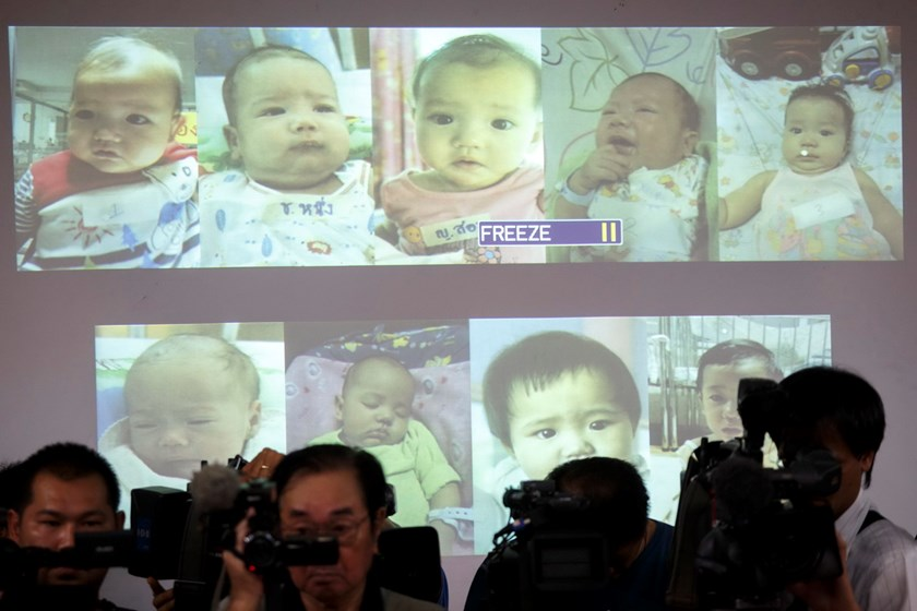 Surrogate babies that Thai police suspect were fathered by a Japanese businessman who has fled from Thailand are shown on a screen during a news conference at the headquarters of the Royal Thai Police in Bangkok August 12, 2014. Photo: Reuters