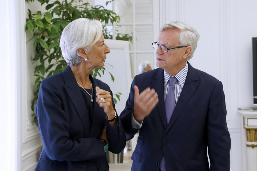 "IMF chief Christine Lagarde speaks to her lawyer, Yves Repiquet, on August 27, 2014, in Paris, after announcing she had been charged for ""negligence"" over a multi-million-euro corruption case relating to her time as French finance minister in 2008. The ca"