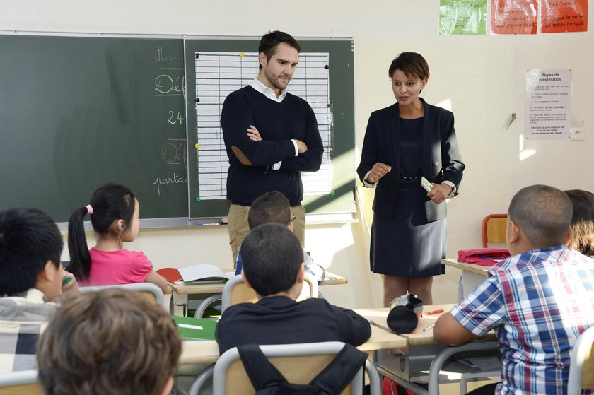 Newly appointed French Education Minister Najat Vallaud-Belkacem (R) stands on September 3, 2014 next to teacher in a class at the Denis Diderot elementary school in the Paris suburb of Gennevilliers during a visit of the school on the second day of the n