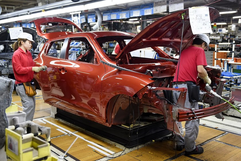 Employees of Japan's auto giant Nissan Motor work at an assembly line of its Oppama Plant in Yokosuka, suburban Tokyo, on September 8, 2014. An extra 600 million jobs needed to be created worldwide by 2030 just to cope with the expanding population, says