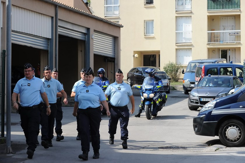 French police walk outside the police station in Lodeve as three alleged Islamic jihadist militants are readied to be escorted to the city of Montpellier on September 24, 2014. Photo: AFP