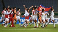 North Korean players celebrate their victory against Japan after their women's football final at Munhak Stadium during the Asian Games in Incheon on October 1, 2014. Photo: AFP