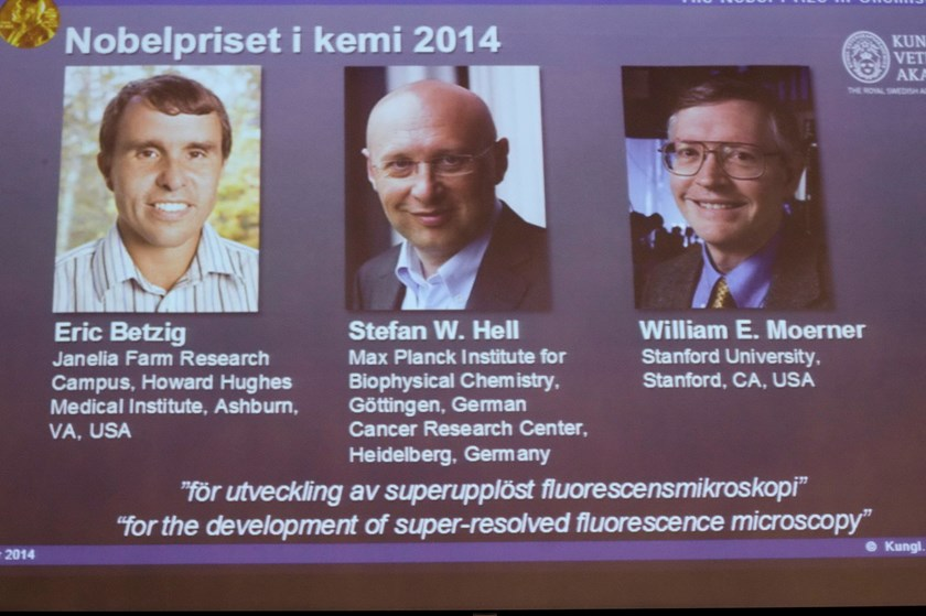 A screen showing the names and pictures of the laureates of the 2014 Nobel Prize for Chemistry, is pictured at the Royal Swedish Academy of Sciences in Stockholm October 8, 2014. American scientists Eric Betzig (L) and William Moerner (R) and Germany's St