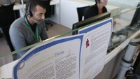 Employees work in a call center in Romainville, a Paris suburb, on October 14, 2014. Photo: AFP