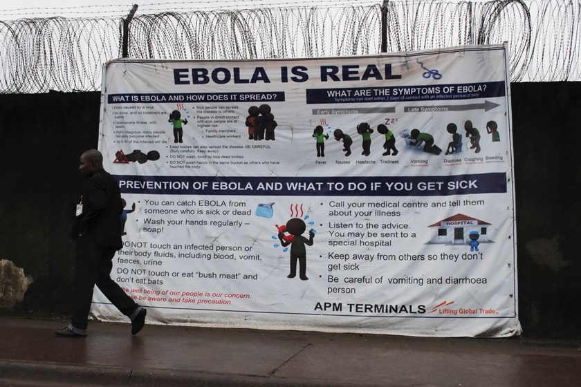 "A man walks by a sign that reads ""Ebola is real"" in Monrovia, Liberia, October 21, 2014. The worst epidemic on record of the deadly virus has now killed more than 4,500 people in Liberia, Sierra Leone and Guinea. Photo: Reuters"