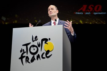 The President of Amaury Sport Organization (ASO) Jean-Etienne Amaury gives a speech, on October 22, 2014 in Paris, during the presentation of the official route of the 2015 Tour de France cycling race which will run during 21 stages from July 4 to 26, 201