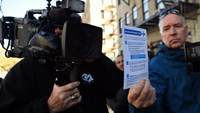 Local media take video of Ebola information outside an apartment building near 172nd Street and Stratford Ave. October 27, 2014 in New York. Photo: AFP