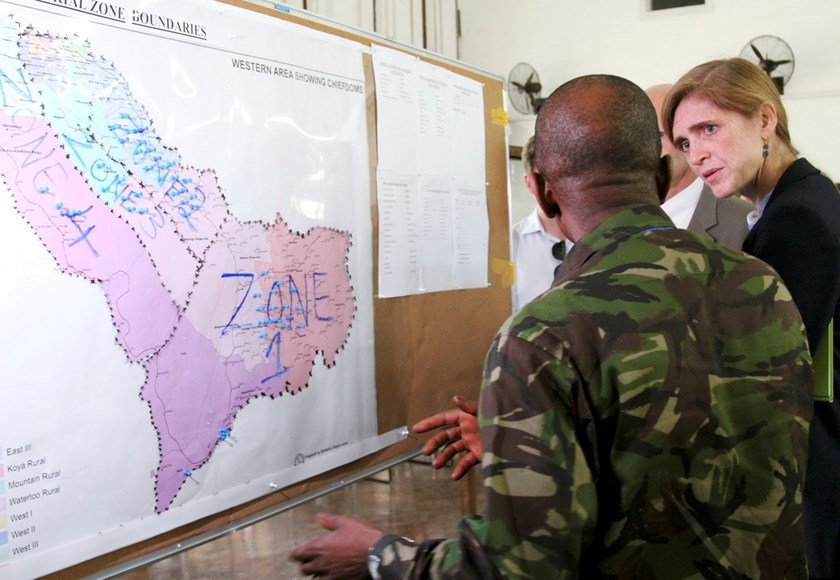 US Ambassador to the United Nations, Samantha Power, (R) visits the Western Area Emergency Response Center in Freetown, Sierra Leone, October 27, 2014. The map on the board is marked with blue pins to show where the bodies of Ebola victims were collected
