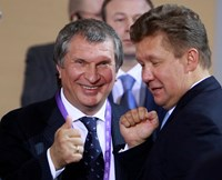 Rosneft CEO Igor Sechin (L) and Alexei Miller, the head of Russian gas giant Gazprom, chat as they wait for the address by Russian President Vladimir Putin at the international businessmen gathering ahead of a summit of leaders of the 21-member Asia-Pacif