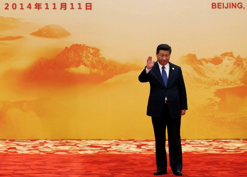 China's President Xi Jinping waves during a welcoming ceremony of the Asia Pacific Economic Cooperation (APEC) forum inside the International Convention Center at Yanqi Lake in Beijing November 11, 2014. Photo: Reuters/Kim Kyung-Hoon