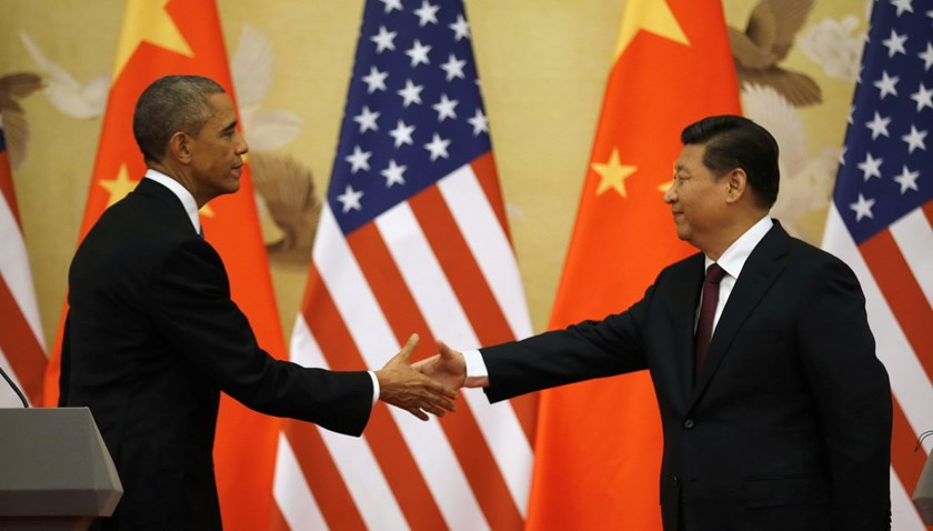 U.S. President Barack Obama (L) and Chinese President Xi Jinping shake hands at the end of their news conference in the Great Hall of the People in Beijing November 12, 2014. Photo: Reuters