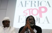 "Ivorian reggae singer Tiken Jah Fakoly (R) and Malian singer Mory Kante attend a news conference to present the ""Africa Stop Ebola"" album in Paris, November 24, 2014. Some of Africa's top musicians launched on Monday an Ebola appeal song with proceeds goi"