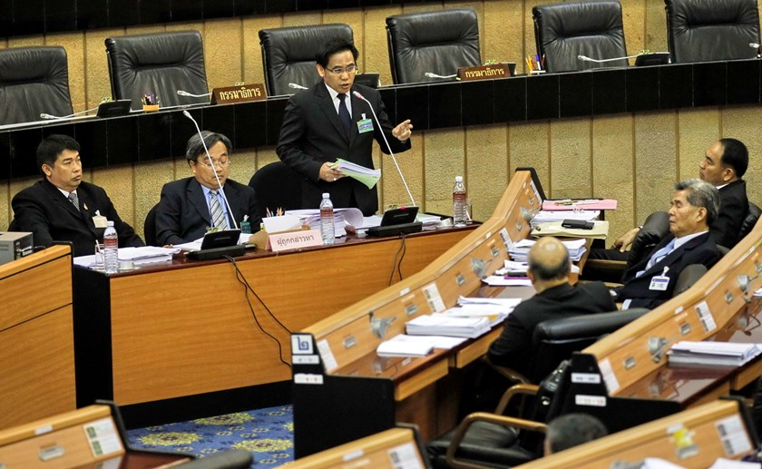 Norawit Laleang (3rd L), lawyer of former Thai Prime Minister Yingluck Shinawatra, speaks to National Legislative Assembly members during a meeting to start impeachment proceedings against Yingluck at the Parliament in Bangkok November 28, 2014. Photo: Re