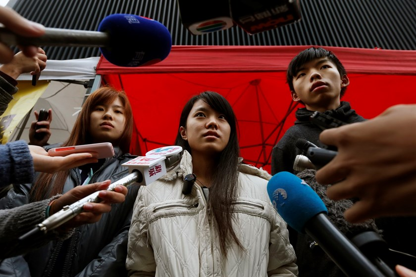 (L-R) Isabella Lo, Prince Wong and student leader Joshua Wong speak to journalists during their hunger strike outside the government headquarters in Hong Kong December 2, 2014. Photo: REUTERS