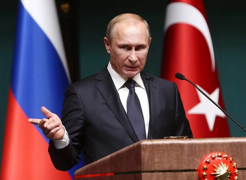 Russian President Vladimir Putin listens to a question as he speaks to the media during a joint news conference with his Turkish counterpart Recep Tayyip Erdogan at the new Presidential Palace in Ankara on December 1, 2014. Photo: AFP