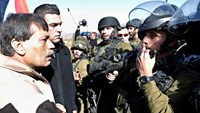 Palestinian minister Ziad Abu Ein (L) argues with Israeli soldiers during a protest near the West Bank city of Ramallah December 10, 2014. Photo: Reuters