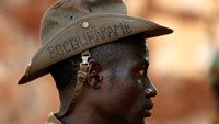"A Seleka fighter wears a hat that reads ""Bocou Harame"", in a reference to the Islamist militant group Boko Haram, in the town of Bria, in this April 9, 2014 file photo. Photo: Reuters"