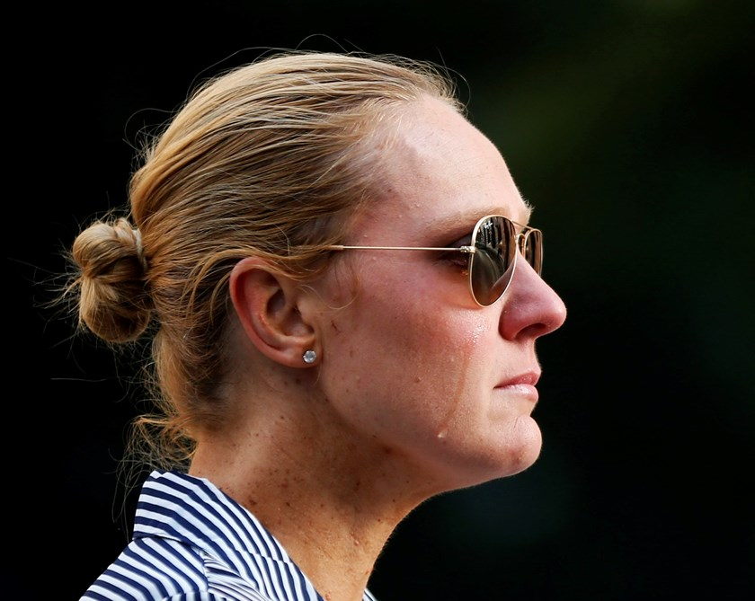 Sydney resident Kate Golder cries as she observes the site of a Sydney cafe siege after it ended in Martin Place, December 16, 2014. Photo: Reuters