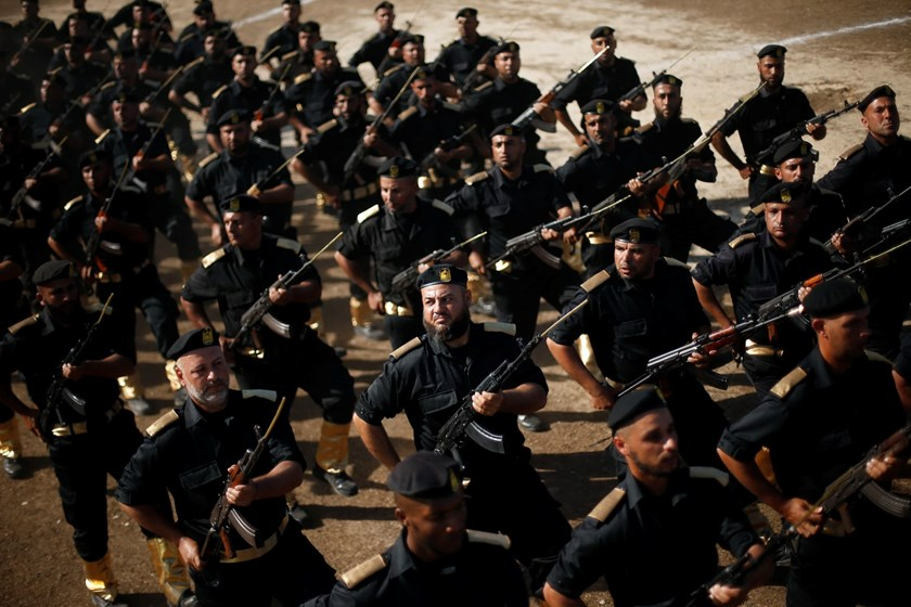 Members of Palestinian security forces loyal to Hamas march during a graduation ceremony in Gaza City in this December 4, 2014 file photo. Photo: Reuters