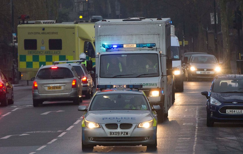 A convoy carrying a female Ebola patient arrives at the Royal Free Hospital in London December 30, 2014. The patient, a voluntary health worker, was flown to London for specialist treatment at an isolation ward after being taken ill a day after returning