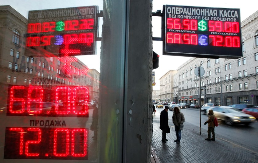 As oil falls, Russia choked by military, social spending