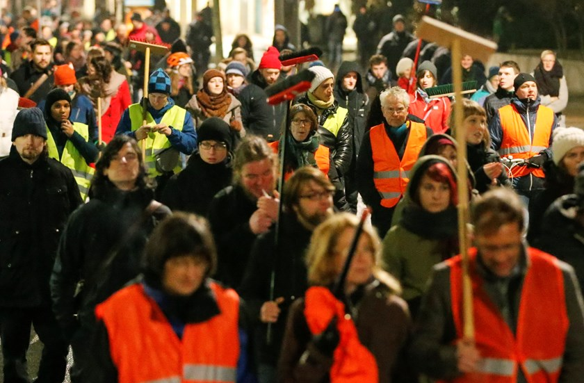 "Participants of an alternative rally carry brooms as they protest against a demonstration called by anti-immigration group PEGIDA, a German abbreviation for ""Patriotic Europeans against the Islamization of the West"", in Dresden January 5, 2015. Photo: Reu"